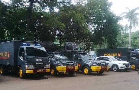 polisi berjaga untuk final piala sudirman